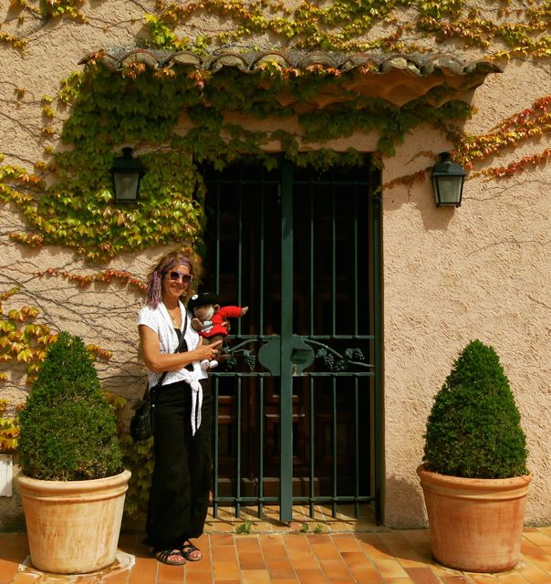 Aysha and her traveling companion IggyMo (who has his own Facebook page!) pose in front of a winery in Provence.